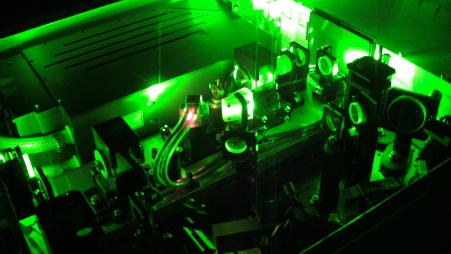 This is what a high-powered scientific laser looks like! The box in the upper left corner is where the laserlight comes from, and the rest of those things are mirrors to tweak the light to be just how we like it.