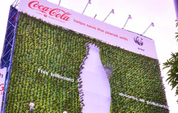 "A ""living"" billboard made of tea plants growing in recycled Coke bottles. Image source."