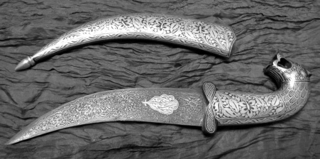 A beautiful example of a Damascus steel knife. Notice the dark patterns—similar to both soot and the cave paintings. Image source.