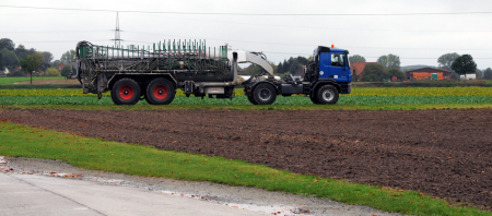A sewage sludge application truck. Many cities offer the application of this sludge to fields as a free service.