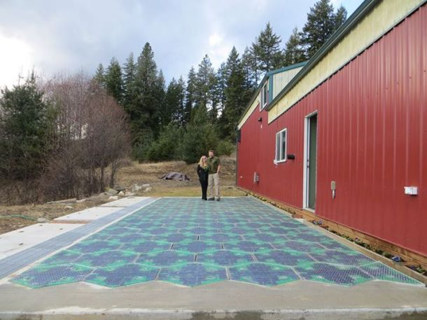 Julie and Scott Brusaw with a parking lot prototype. Image copyright Solar Roadways. https://www.facebook.com/pages/Solar-Roadways/41869107125