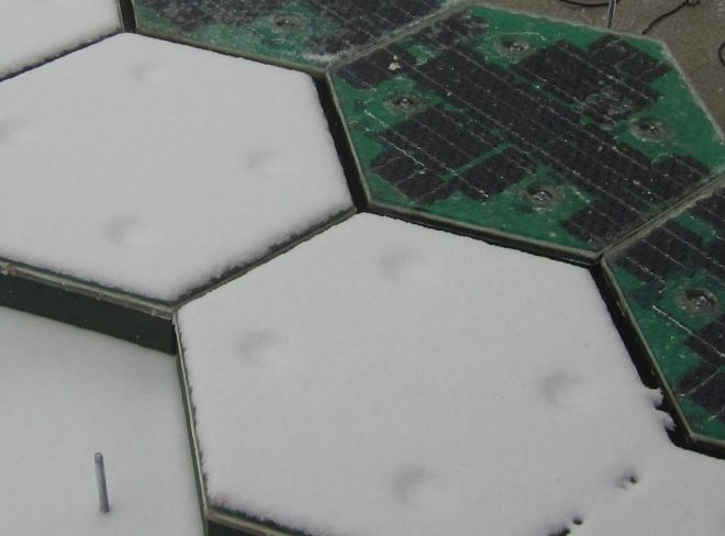 Solar roadway prototype demonstrating the heating capabilities. Image copyright Solar Roadways.  http://www.facebook.com/solarroadways