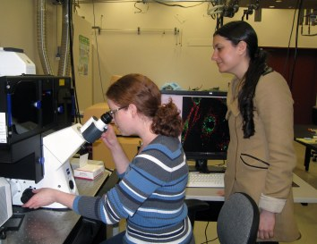 Two of the scientists in our center using a microscope at the Pacific Northwest National Laboratory.
