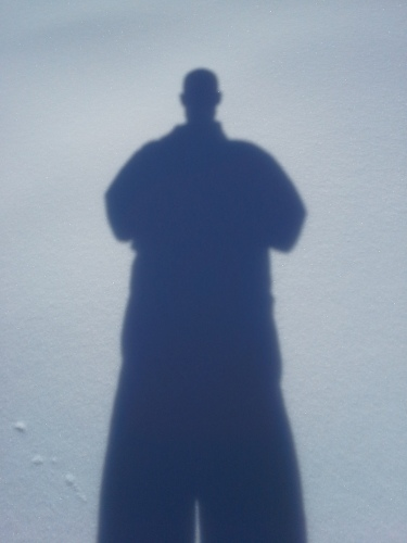 The shadow of a human being falls across some beautiful freshly fallen snow.  The bad news: odds are that the human forming this shadow has detectable levels of triclosan in their body.